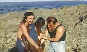 black hotty deep-throating two White boys on the seaside