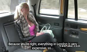 huge-boobed British blonde takes brown-eye in fake taxi