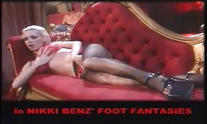 Nikki Benz in red panty providing a foot job to another hotty with a good rack